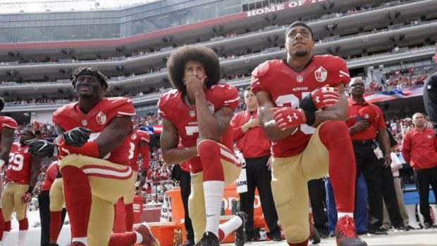 KAEPERNICK SETTLES COLLUSION SUIT IMAGE